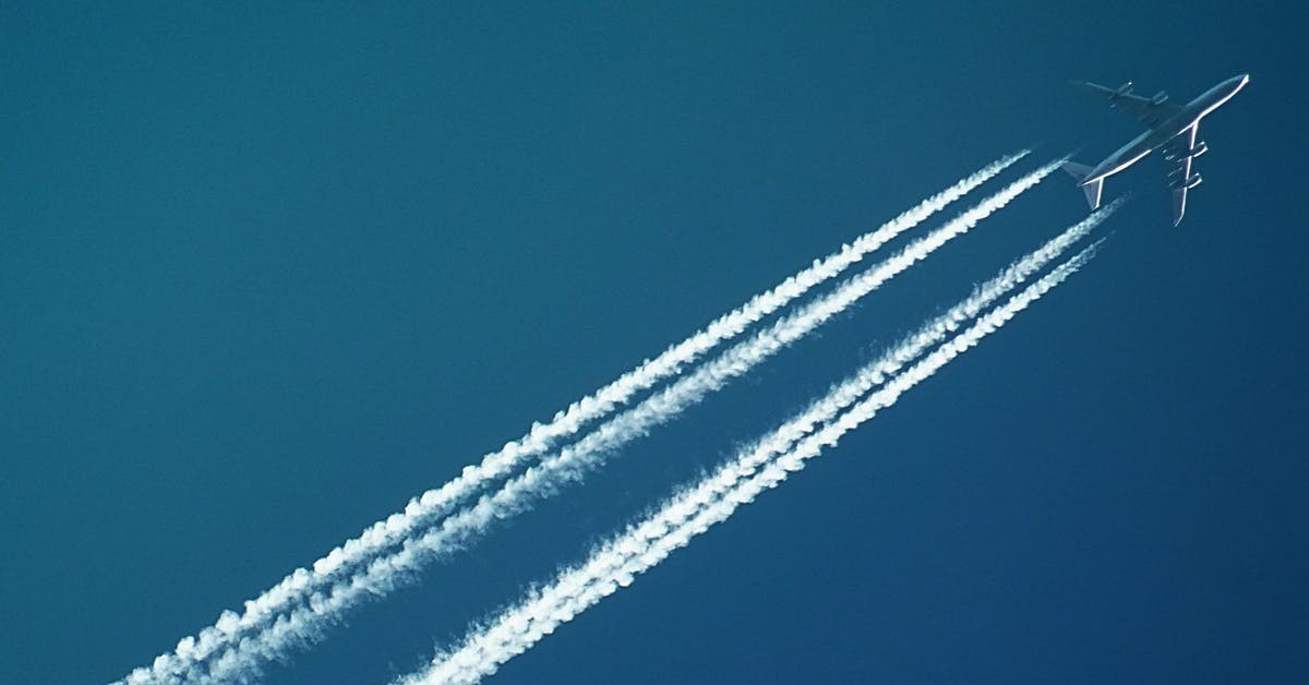 contrails of an airplane crossing the sky
