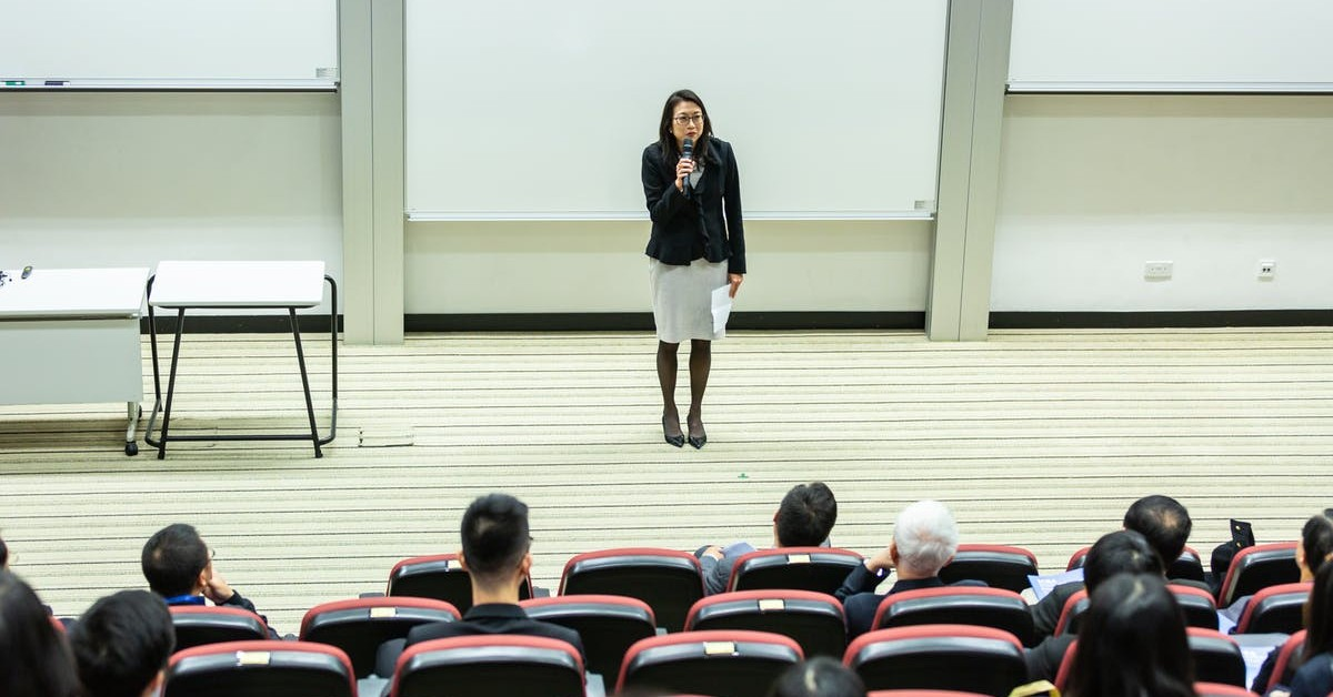 instructor in front of a lecture hall