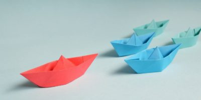 leader of a fleet of paper boats