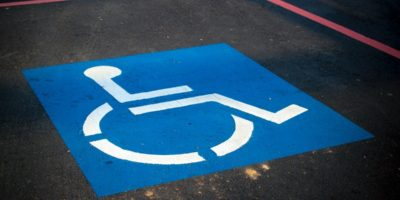 handicap parking sign in a parking space.