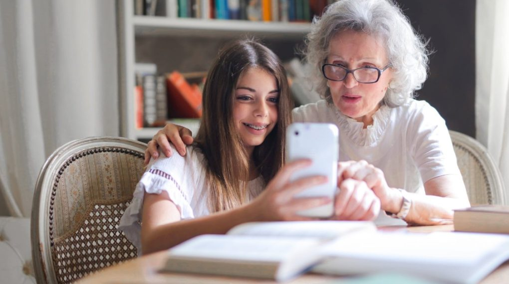 and elderly woman with her granddaughter learning together